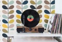 This high-performance vertical turntable with full-range stereo speakers is also a stylish design element for your home.