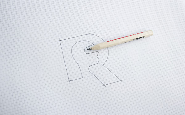 A pencil sketch of the logo.
