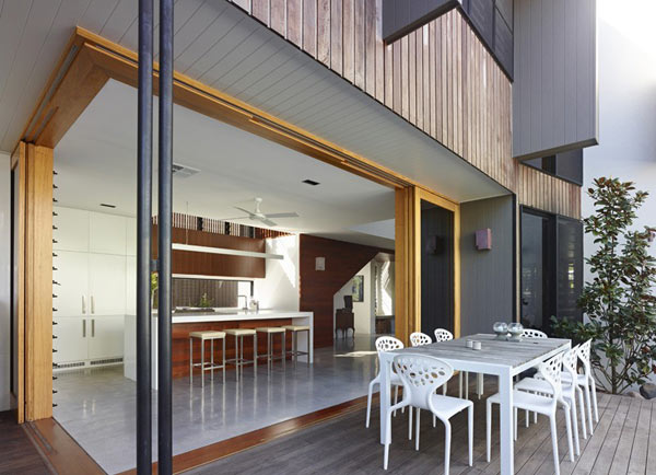 The kitchen space offers an open connection to the terrace.