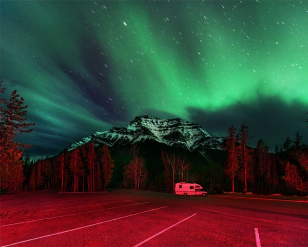 Camper at Highway 93 in front of Mt Kerkeslin (Jasper nationnal park) and stunning auroras.