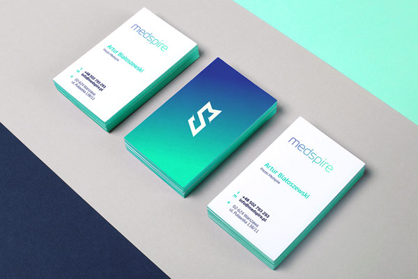 The two-sided business cards with a striking color gradient from blue to turquoise.