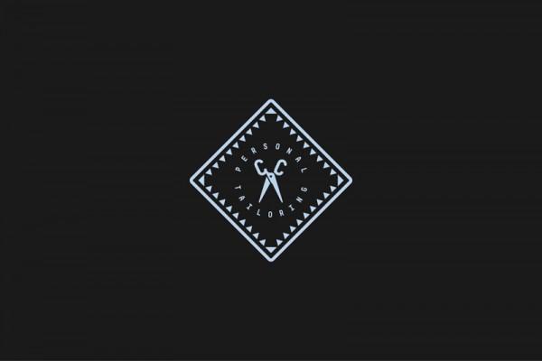 Tailor shop logo on black background.