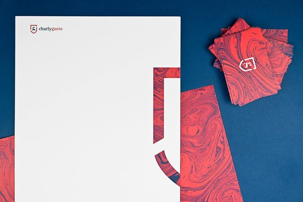 Corporate identity and marbled stationery with a British touch created by Mubien Studio for Charly Gusto.