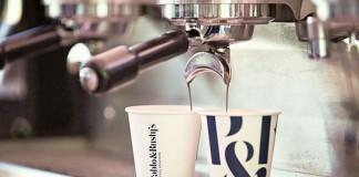 Two cups under the espresso machine.