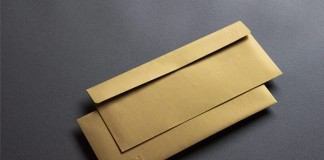 Golden envelopes with embossed logotype.