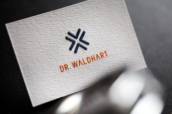 Corporate design by bureau rabensteiner for dr waldhart the letterpress business cards with simple white background are printed on a natural paper with a reheart Choice Image