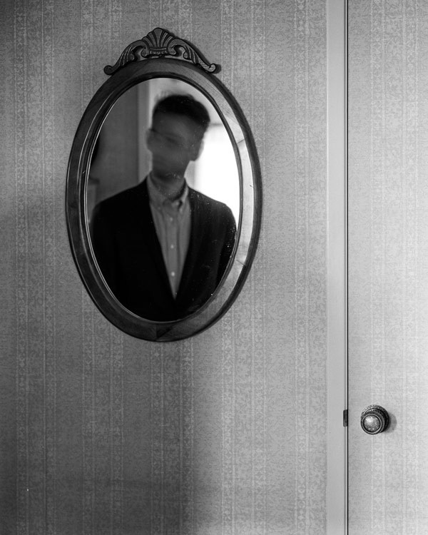Who is this man in the mirror?