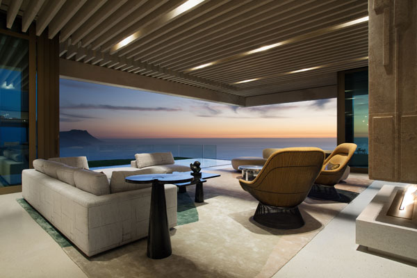 The house offers breathtaking views of the ocean and the surrounding landscape.