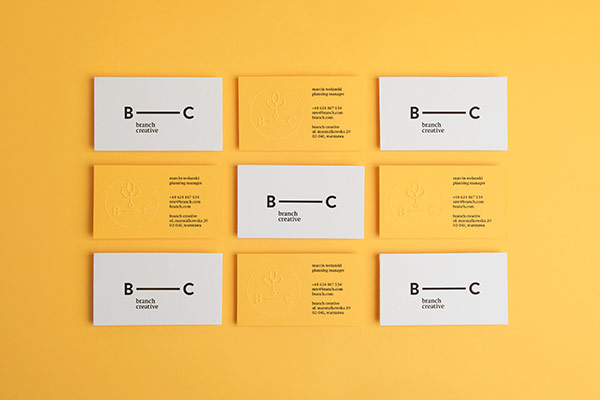 Two-sided business cards in black and yellow colors.