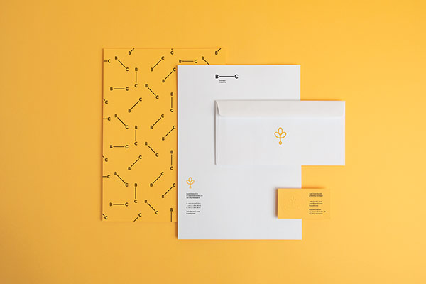 The stationery set including letterheads, business cards, and envelopes.