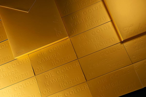Design studio Paperlux also created a range of golden packaging for the 2015 edition of the annual event.