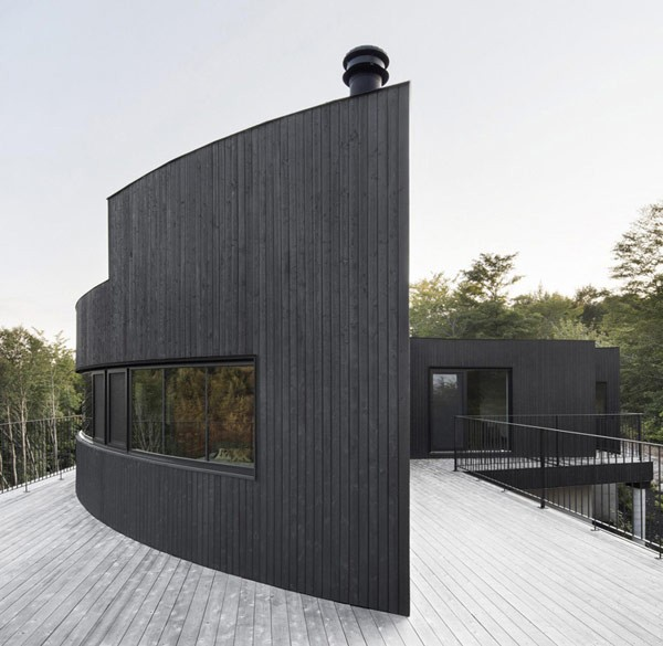 A tapered bow forms the end of the house.