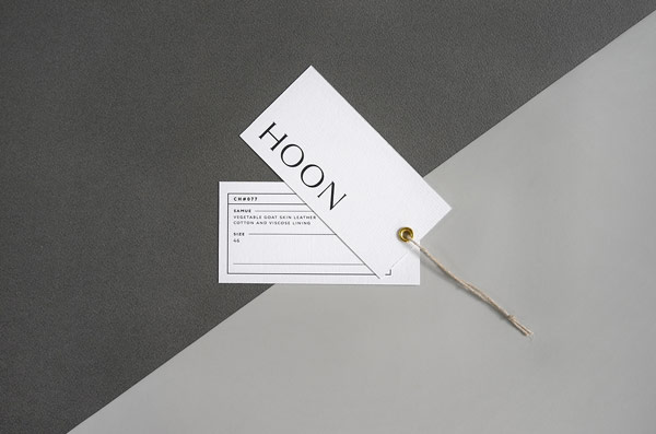 Two hang tags designed by French Say What Studio for the HOON leather shop.