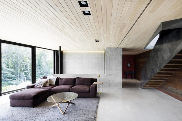A home in quebec 39 s wooded landscape by alain carle for Minimalist house quebec