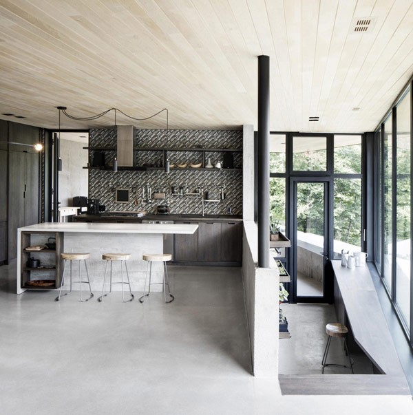 The bright and open kitchen design with windows down to the floor.