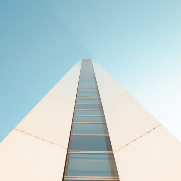 Looking up a tall tower.