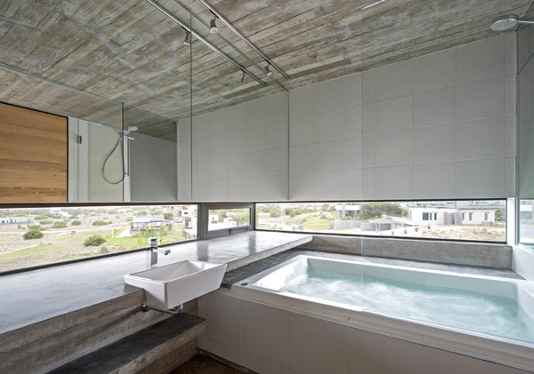 What a beautiful bathroom with great views the surrounding area.