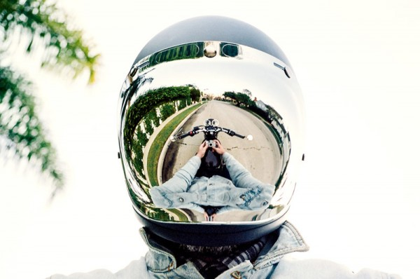 A selfie by Benjamin Heath with helmet on his motorbike.