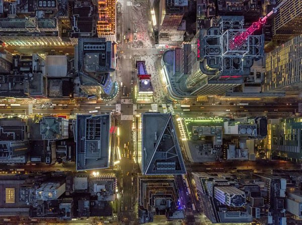 A collection of aerial photographs captured by Jeffrey Milstein above the roofs of New York City.