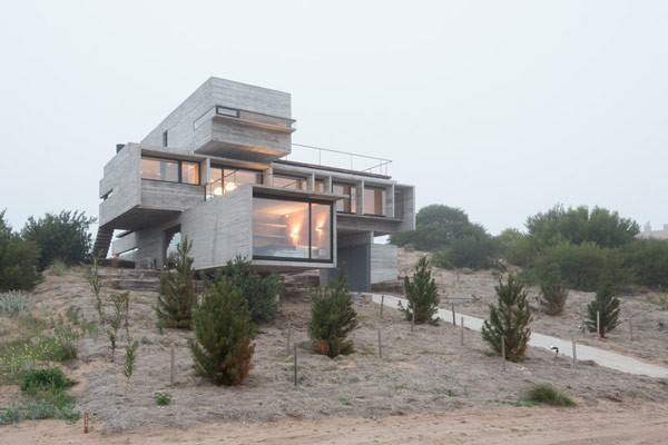 The modern house is overlooking a golf course in Argentina.