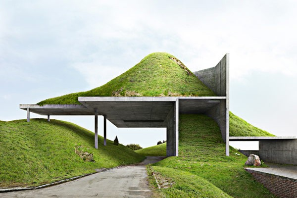A completely new architectural construction of concrete and a lot of green grass.