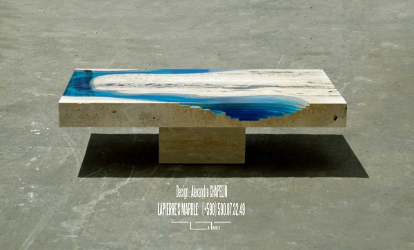 The table has been sculpted from a piece of marble.