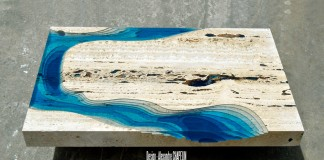 The coffee table has a sculpted drop to show the slopes of the ocean or the lagoon.