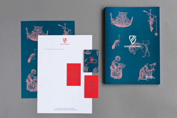 The printed collateral including stationery, business cards, and the company brochure.