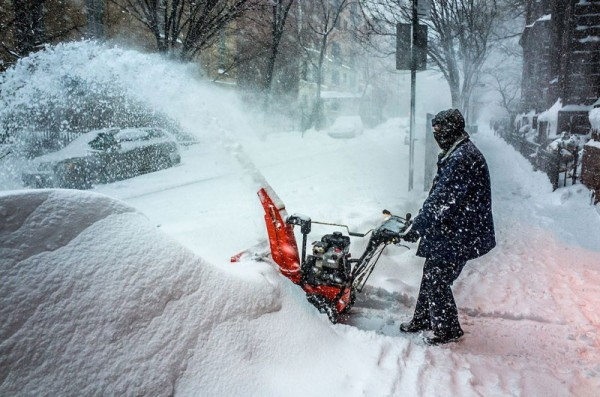 A man carves his way through the snow.