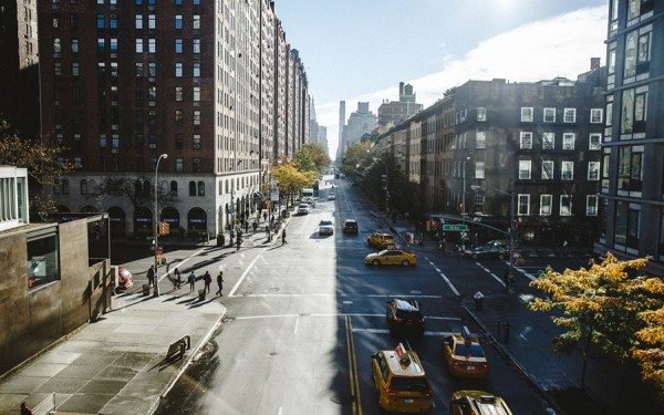 A sunny setting at an intersection of 10th Avenue.