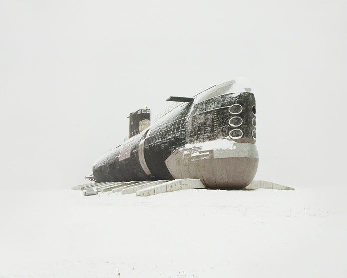 An old submarine from the Soviet era weathered in the snow.