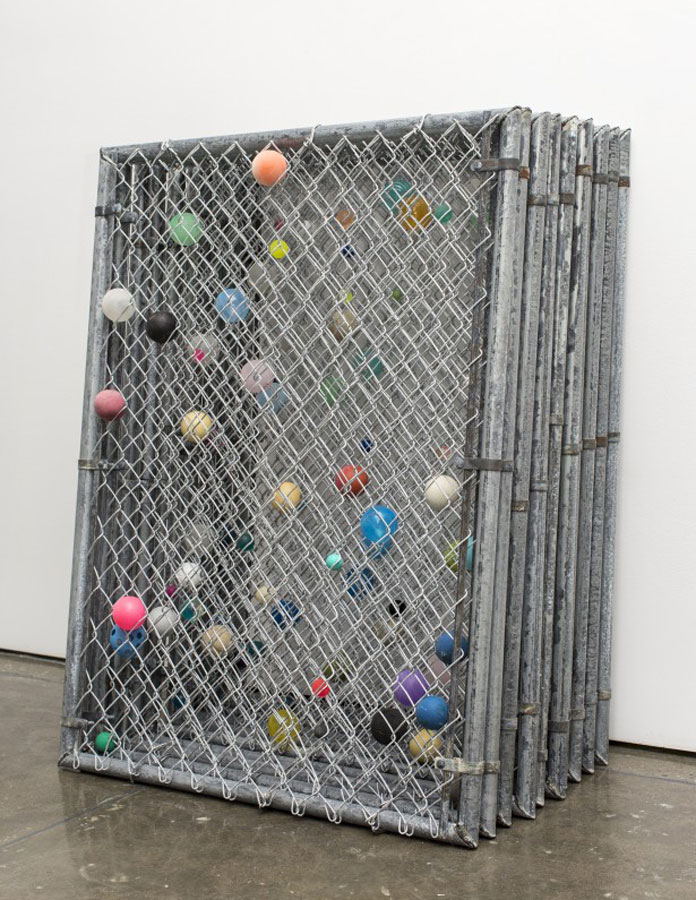 Installation from 2015 with balls in chain link frames.