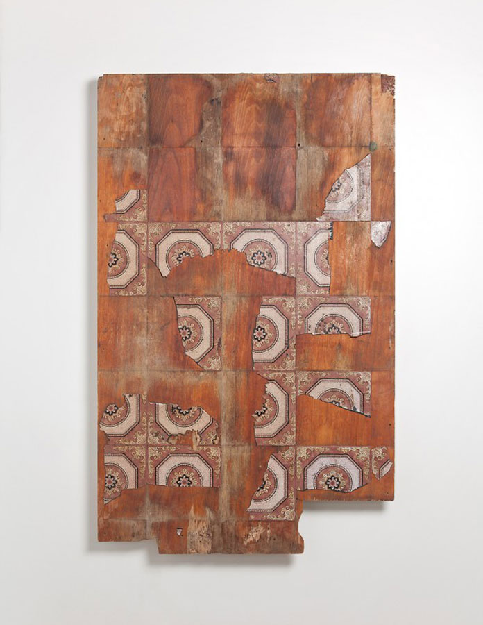 This mixed media artwork is utilizing old tiles.