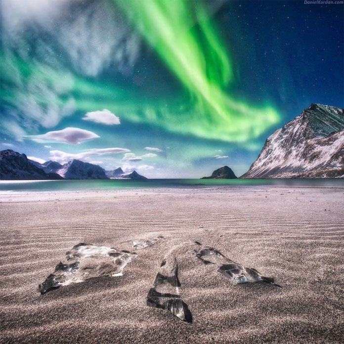 Wonderful aurora borealis over Haukland beach, Lofoten, northern Norway.