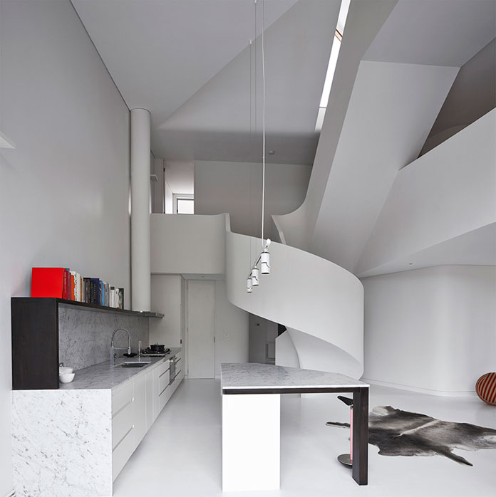 A loft apartment by AAArchitects in West Melbourne VIC, Australia.