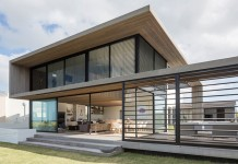 A modern family home designed by Julian Guthrie on a coastal property in Omaha, New Zealand.