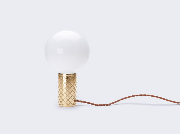 The minimalist design is inspired by a bicycle grip that holds a light bulb.