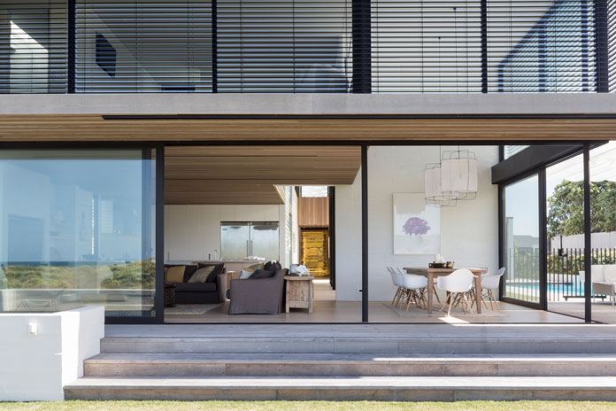 Large sliding glass walls offer an amazing indoor-outdoor living experience.