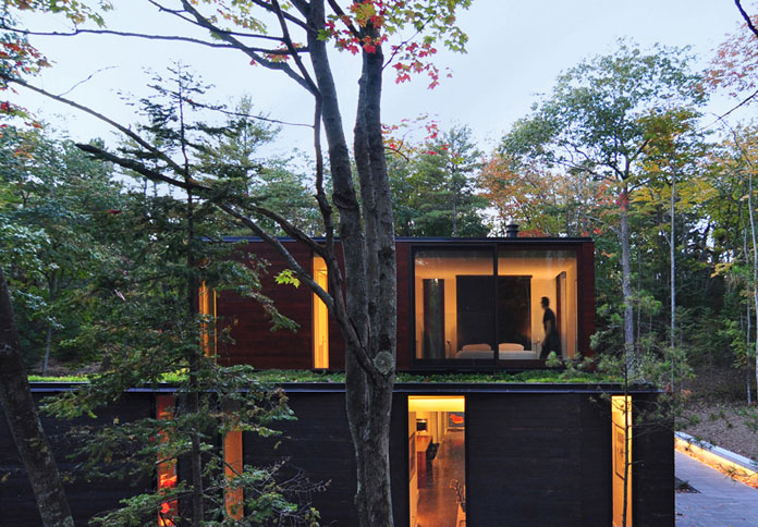 The exterior of this beautiful home is made of a variety of materials such as charred cedar siding as well as varnished clear cedar, dark-anodized aluminum, and glass.