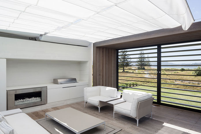 A great feature of the house is this outdoor room, with a retractable shade cover, that has a fireplace, sitting area and BBQ.