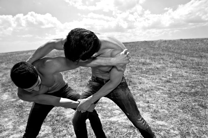 Image of Michalis Egoumenides and Sergiou Eftichios from a photographic essay, celebrating masculinity, friendship and boundaries.