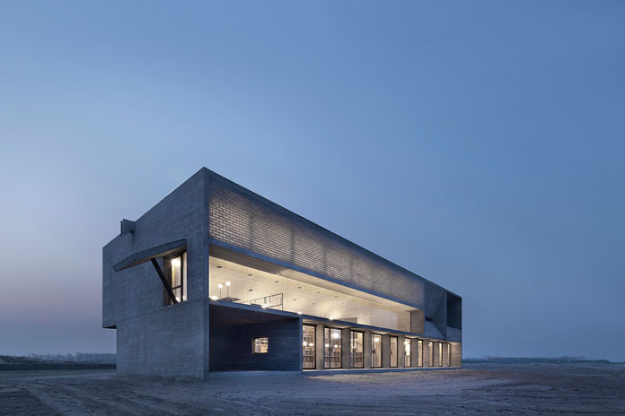 The Seashore Library – modern and minimalist concrete-clad monolithic architecture designed by Vector Architects.