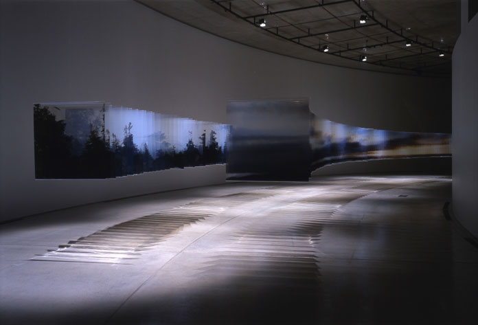 Installation view of countless acrylic panels.