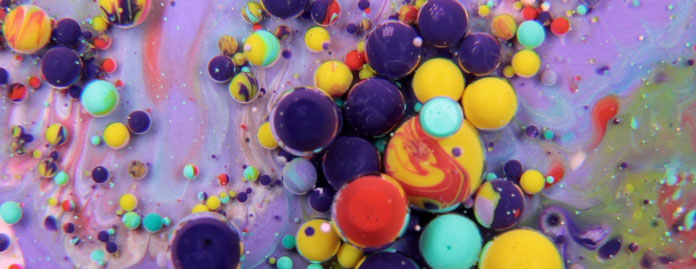 The short video provides a dreamlike and colorful take on circular moves and liquids.