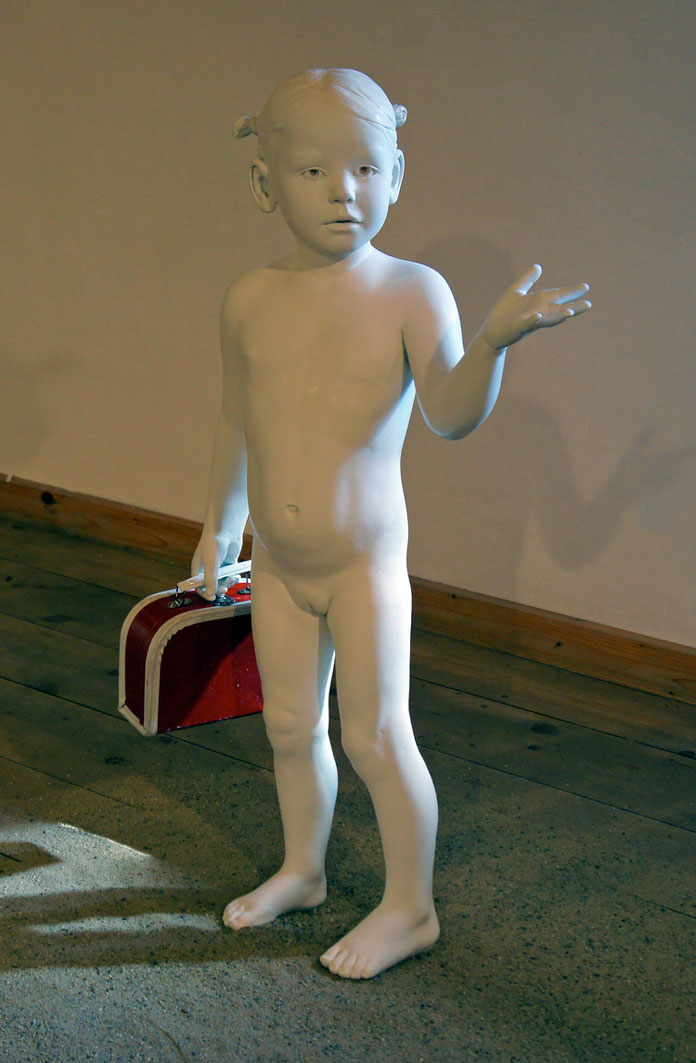 Little girl with suitcase, another beautiful ceramic sculptured crafted by May Von Krogh.