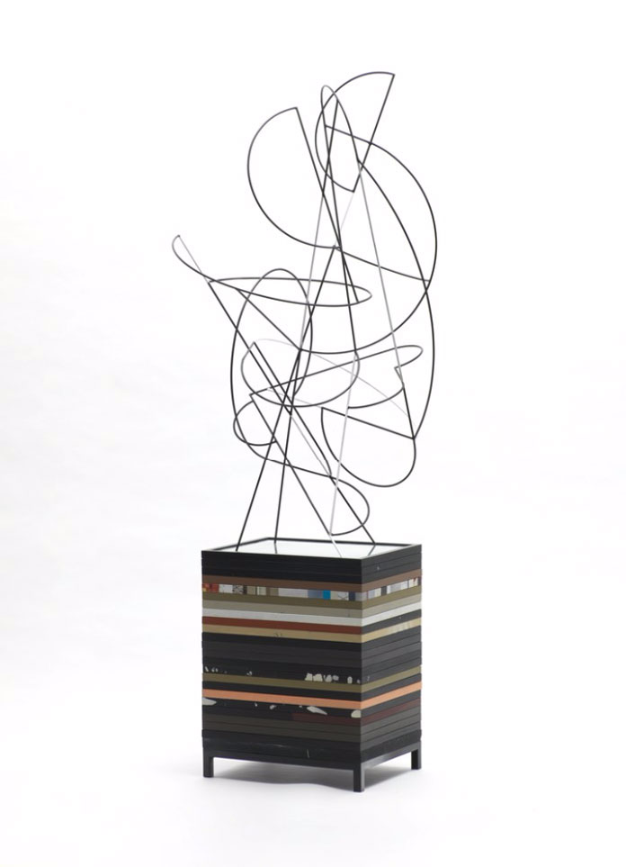 Sculpture created with metal, wood, glass, paint.