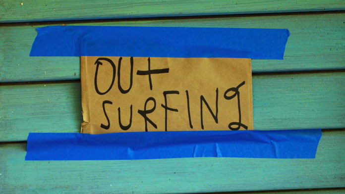 """Out Surfing"", that note at his door says it all."