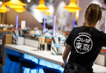 Black t-shirts with logo print for the staff.