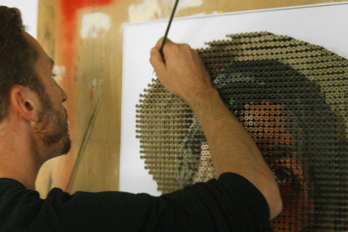 Andrew Myers hand paints each screw head.