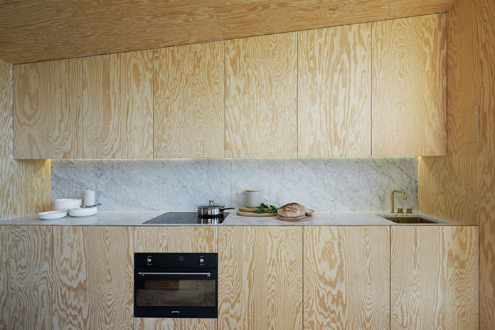 The kitchen area. Each wall inside the house is made of wood.